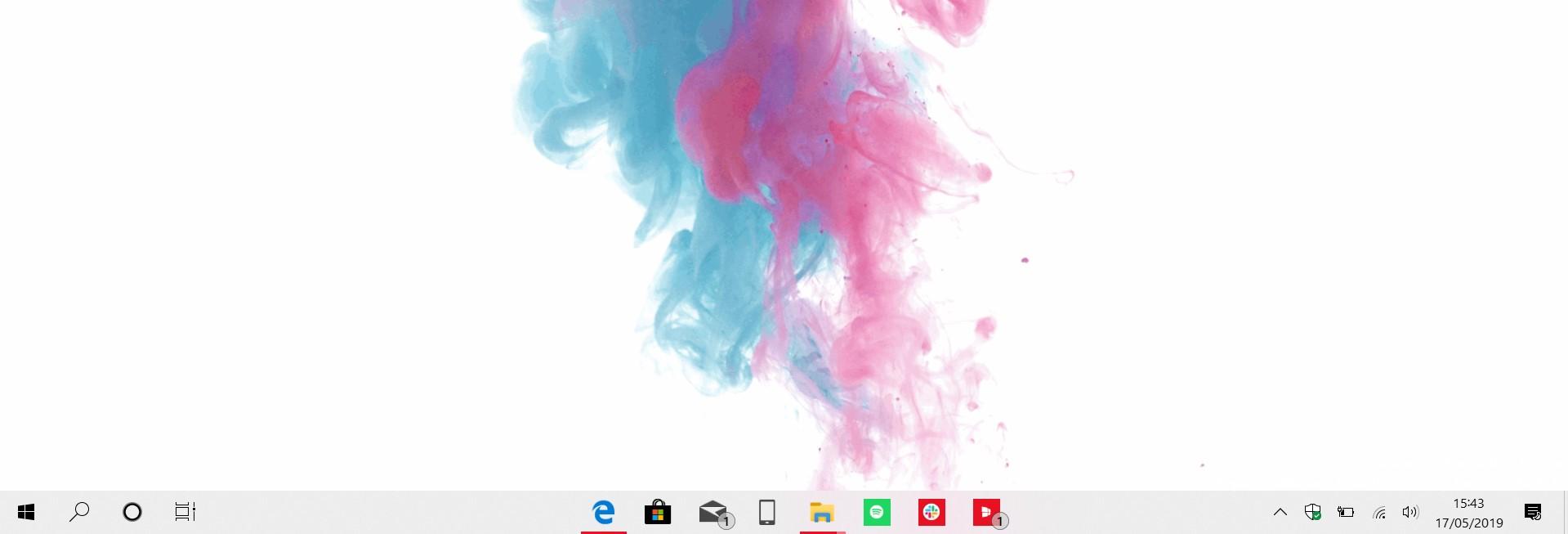 Icone centrate sulla barra delle applicazioni in Windows 10